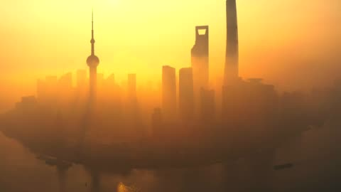 drone shot 4k aerial view of shanghai skyline with fog  pollution environmental problem view near the  oriental pearl tower in shanghai, china. - smog stock videos & royalty-free footage