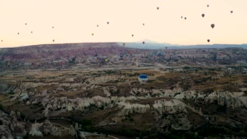 drone shot: 4k hot air balloons cave city in cappadocia, turkey - hill stock videos & royalty-free footage