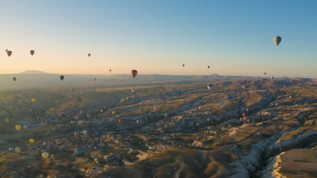 drone shot: 4k hot air balloons cave city in cappadocia, turkey - country geographic area stock videos & royalty-free footage