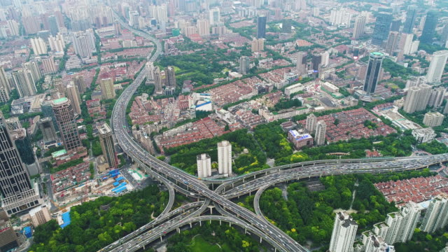 Drone shot: 4K Modern skyline, cityscape and traffic of shanghai.