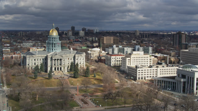 drone shot approaching civic center park and the colorado state capitol building, denver - state capitol building stock videos & royalty-free footage