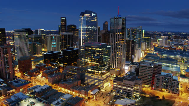 drone shot approaching downtown denver skyline at twilight - denver stock videos & royalty-free footage