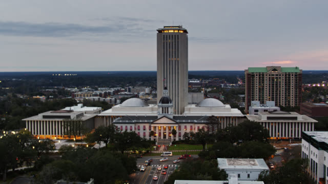 drone shot approaching old and new florida state capitol buildings over apalachee parkway - florida us state stock videos & royalty-free footage