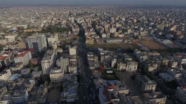 drone shot captures the densely packed city of gaza, palestine. the shot shows clustered buildings. - gaza strip stock videos & royalty-free footage