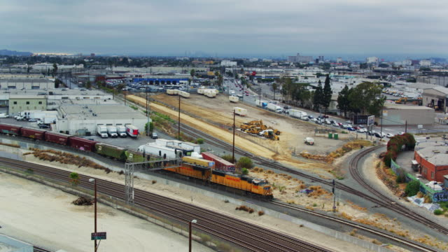 Drone Shot Circling Around Freight Train on the Alameda Corridor, Los Angeles