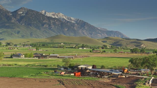 drone shot circling around utah dairy farm - barn stock videos & royalty-free footage