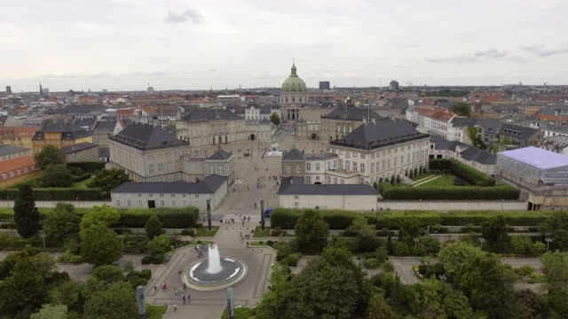 drone shot copenhagen amalienborg palace - stock video - palace stock-videos und b-roll-filmmaterial