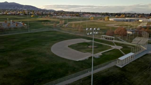 drone shot empty baseball diamond - baseball diamond stock videos and b-roll footage