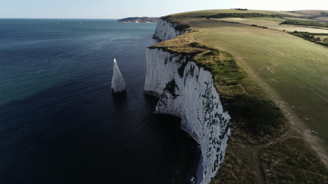 drone shot flying along chalk cliffs, dorset, england, united kingdom - rock face stock videos & royalty-free footage
