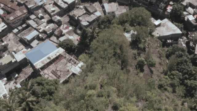 Drone shot flying over a viewing outpost towards the city of Domoni on the island of Anjouan.