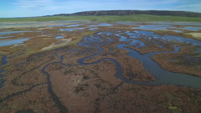 Drone shot flying over a wetlands area on the coastline of Cadiz province, Spain.