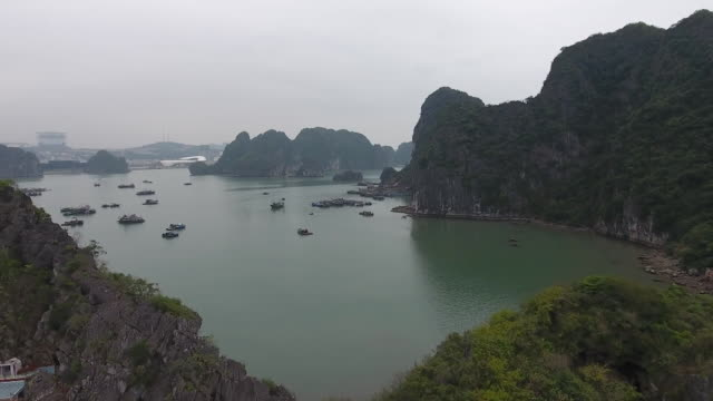 vídeos de stock e filmes b-roll de drone shot flying over ha long bay in vietnam on february 22 2019 - aerial or drone pov or scenics or nature or cityscape