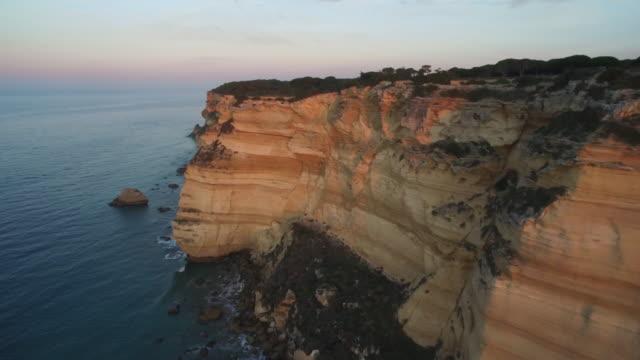 Drone shot flying over the beautiful coastline of the La Breña y Marismas del Barbate Natural Park, Cadiz province.