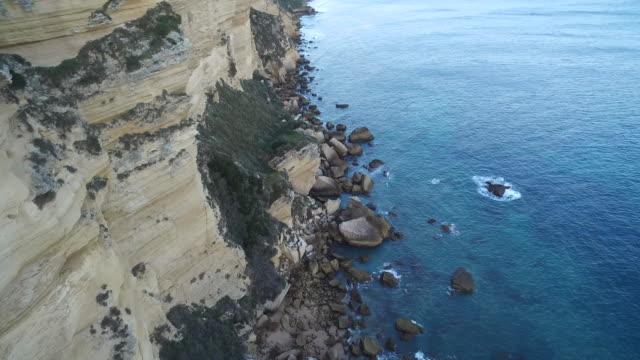 drone shot flying over the spectacular coastline of the la breña y marismas del barbate natural park, cadiz, spain. - rock face stock videos and b-roll footage