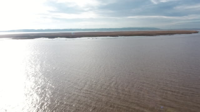drone shot flying over whitton island - shiny stock videos & royalty-free footage