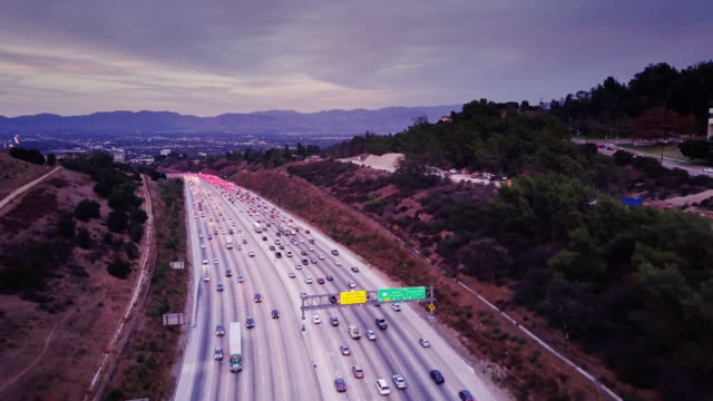 drone shot following 405 into sherman oaks, ca - american interstate stock videos & royalty-free footage
