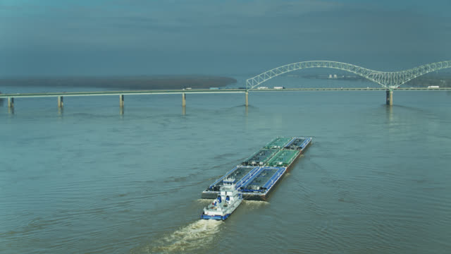drone shot following barge on mississippi - memphis tennessee stock videos & royalty-free footage