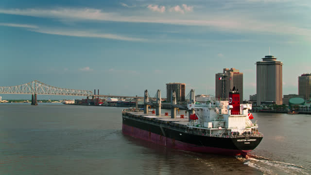 drone shot following bulk carrier up the mississippi past new orleans - gulf coast states stock videos & royalty-free footage
