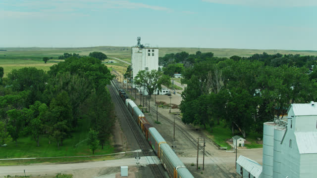drone shot following freight train into lodgepole, nebraska - nebraska stock videos & royalty-free footage