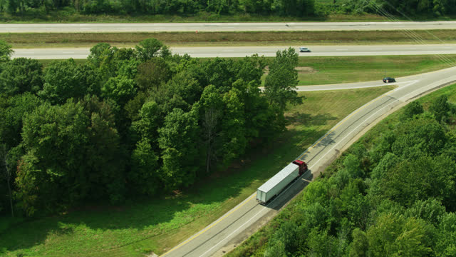 drone shot following truck leaving rest stop - michigan stock videos & royalty-free footage