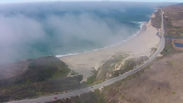 Drone Shot High: Highway 1 at Scott Creek above the fog