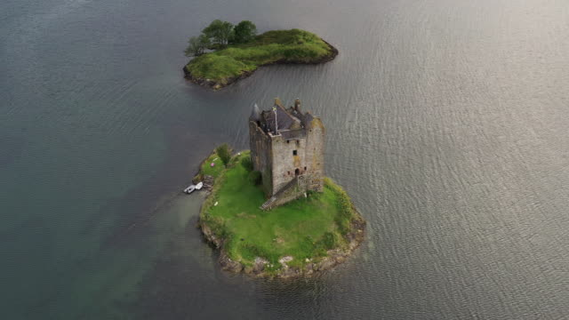 drone shot hovering in front of castle stalker, scottish highlands, united kingdom - dramatic landscape stock videos & royalty-free footage