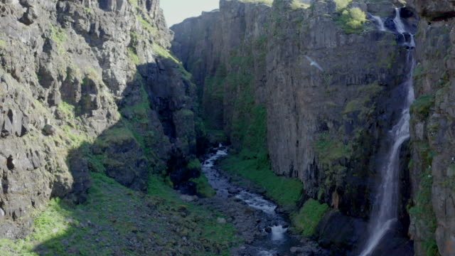 drone shot iceland glymur waterfall bird flying close - swimming shorts stock videos & royalty-free footage