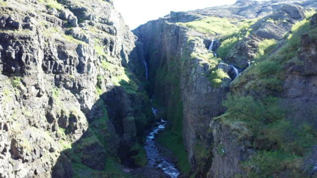 drone shot iceland glymur waterfall take 1 scene 1-9 - pantaloncino da bagno video stock e b–roll