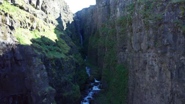 drone shot iceland glymur waterfall take 1 scene 2-9 - pantaloncino da bagno video stock e b–roll