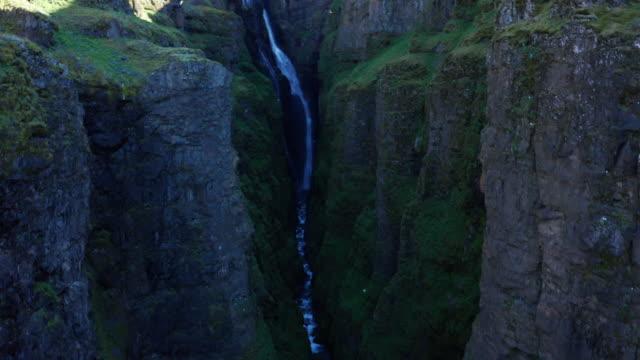 drone shot iceland glymur waterfall take 1 scene 5-9 - swimming shorts stock videos & royalty-free footage
