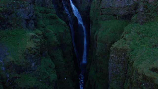 drone shot iceland glymur waterfall take 1 scene 6-9 - swimming shorts stock videos & royalty-free footage