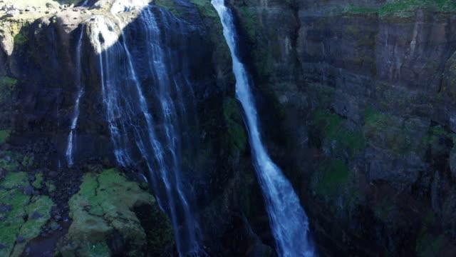 drone shot iceland glymur waterfall take 1 scene 7-9 - swimming shorts stock videos & royalty-free footage