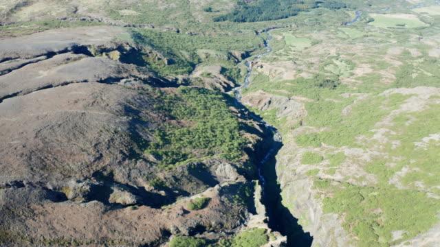 drone shot iceland glymur waterfall - badbyxor bildbanksvideor och videomaterial från bakom kulisserna