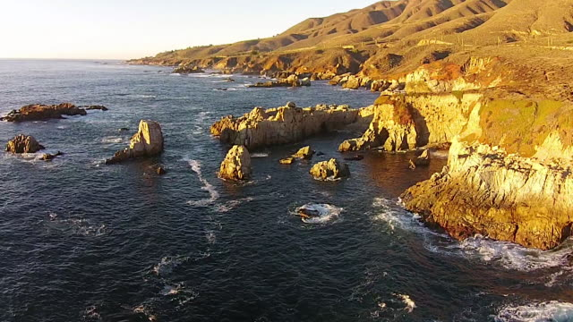 drone shot low: soberanes point big sur fly-by - carmel california stock videos and b-roll footage