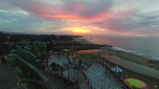 drone shot low to rise: 4k uhd santa cruz beach boardwalk - santa cruz california stock videos and b-roll footage