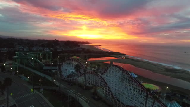 drone shot medium: sunrise at santa cruz beach boardwalk - santa cruz california stock videos and b-roll footage