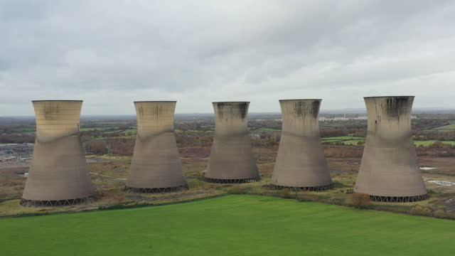 drone shot moving back from smoke stacks at willington power station, derbyshire, england, united kingdom - symmetry stock videos & royalty-free footage