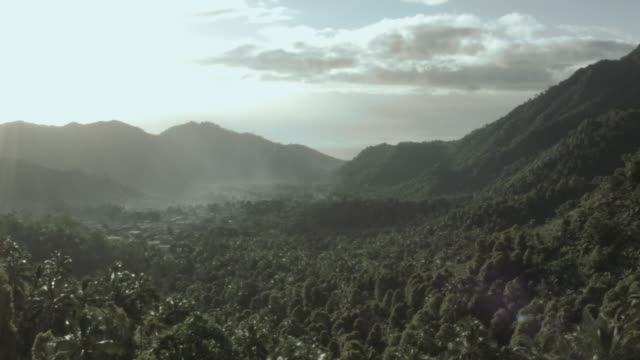 Drone shot moving of a verdant valley on the island of Anjouan.