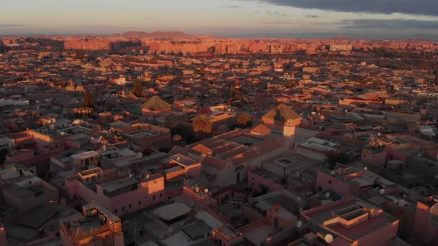 Drone shot of a Moroccan city at sunset