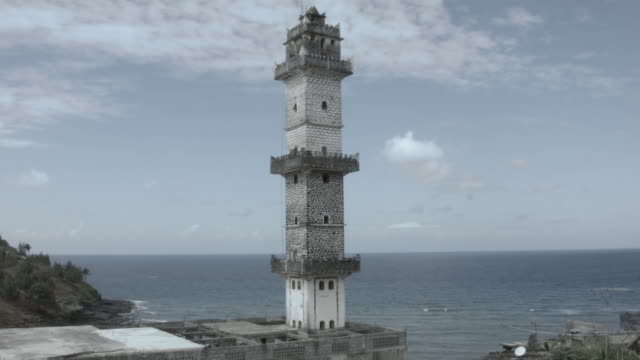 Drone shot of a mosque's tower in the city of Domoni on the island of Anjouan.