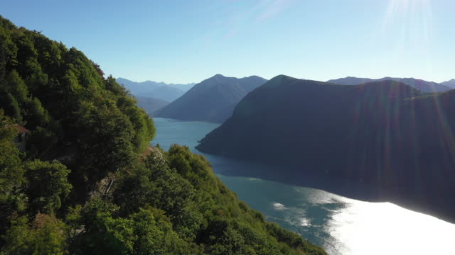 drone shot of a mountain road near a lake - ticino canton stock videos and b-roll footage