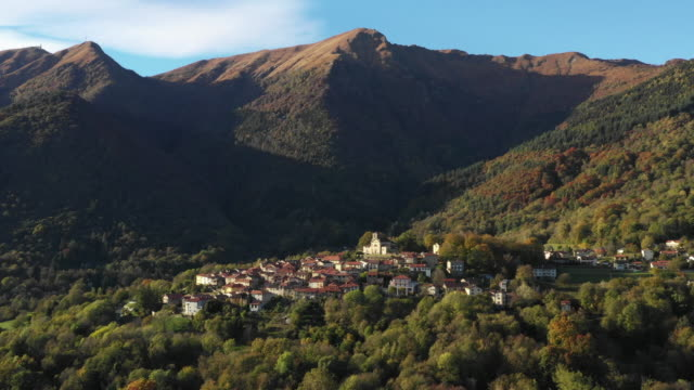 drone shot of a small mountain town in the alps - ticino canton stock videos and b-roll footage