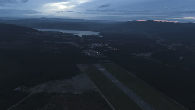 drone shot of airfield at night in norway - airport runway stock videos & royalty-free footage