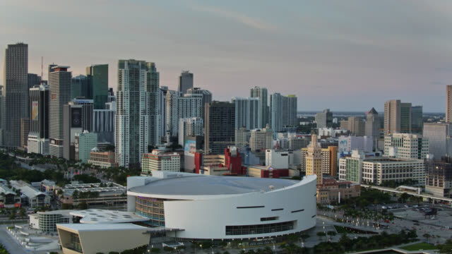 drone shot of american airlines arena and downtown miami at sunrise - bay of water stock videos & royalty-free footage