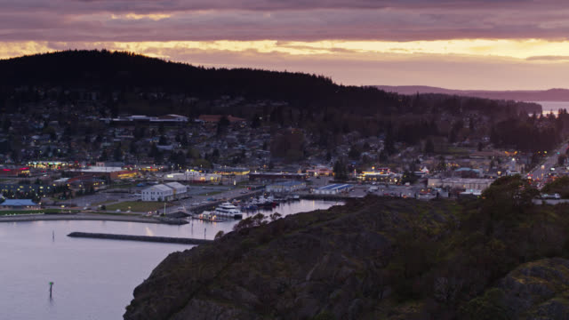 drone shot of anacortes, wa with people watching the sunset from cap sante - anacortes stock videos & royalty-free footage