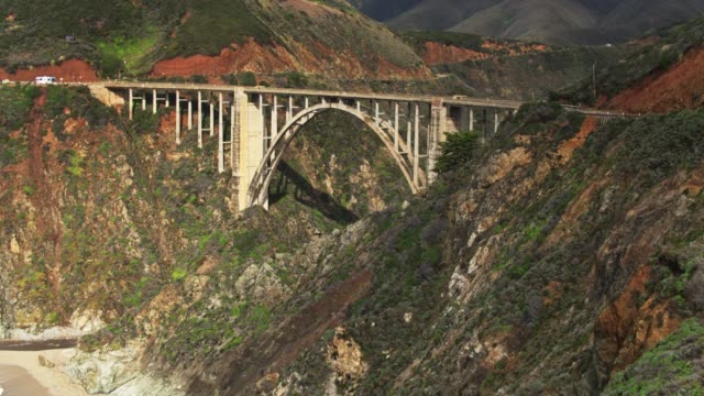 drone shot of bixby creek bridge - bixby creek bridge stock videos & royalty-free footage