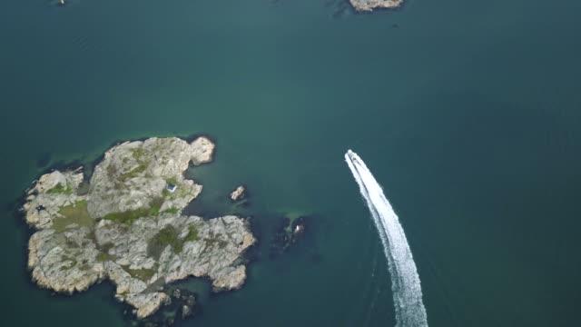 Drone shot of boat going through the Swedish archipelago