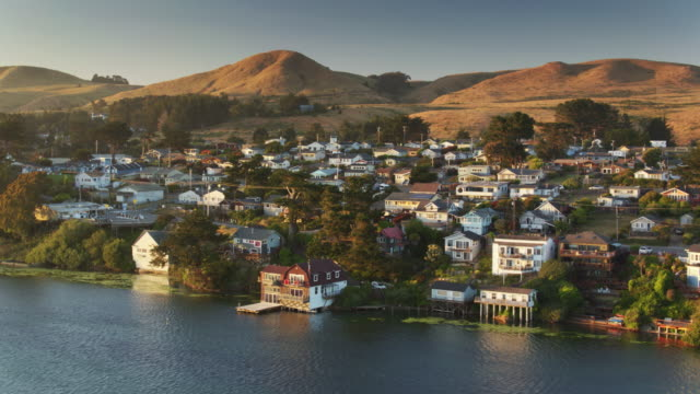 Drone Shot of Bodega Bay Houses and Hills at Sunset