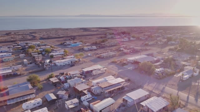 drone shot of bombay beach and the salton sea - abandoned stock videos and b-roll footage