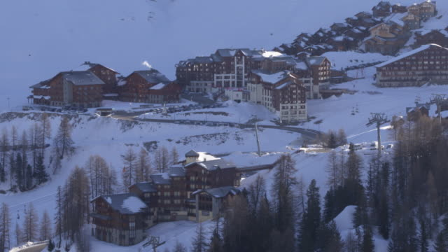 drone shot of buildings on the mountain side of la plagne in france - european alps stock videos & royalty-free footage